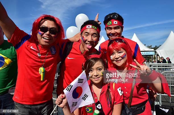 South Korea's fans are pictured outside the stadium before the start of a Group H match between South Korea and Algeria at the BeiraRio Stadium in...