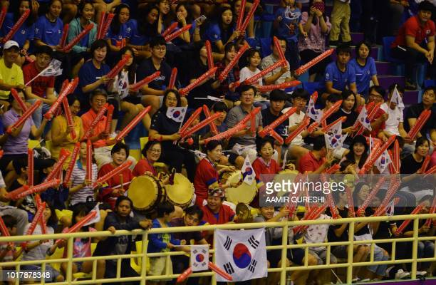 South Korea's fans cheer as they watch the men's handball preliminary Group B match between South Korea and Japan at the 2018 Asian Games in Jakarta...