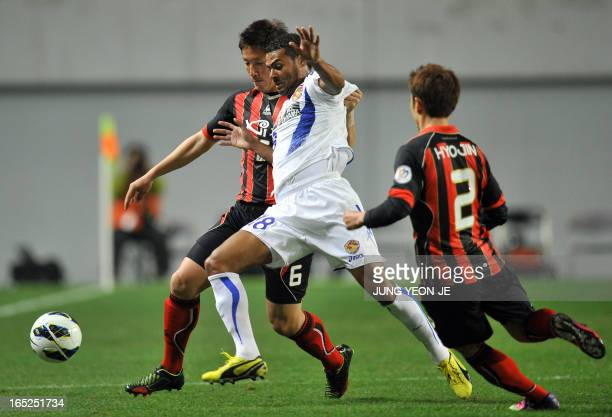 South Korea's FC Seoul defender Kim JinKyu competes for the ball with Japan's Vegalta Sendai forward Wilson Rodrigues Fonseca during the AFC...