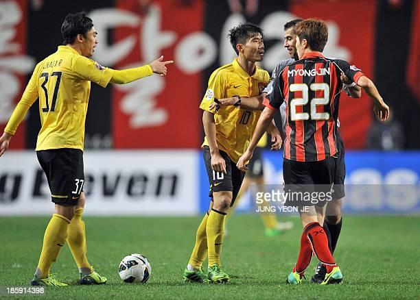 South Korea's FC Seoul midfielder Koh MyongJin argues with China's Guangzhou Evergrande midfielder Zheng Zhi during the first leg of the AFC...