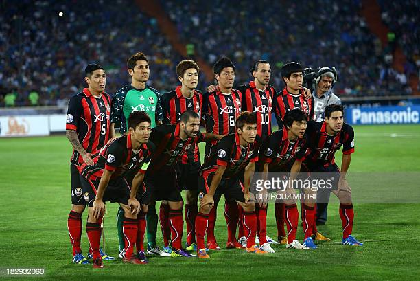 South Korea's FC Seoul players pose for a group picture priot to their AFC Champions League SemiFinal football match against Iran's Esteghlal at...
