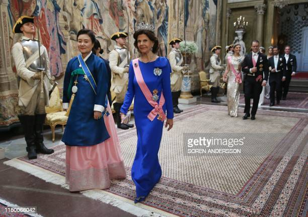 South Korea's First Lady Kim Jungsook and Sweden's Queen Silvia arrive for a State Banquet in honour of the South Korean Presidential couple at the...