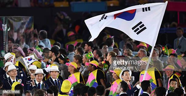 South Korea's flag bearer Gu Bongil leads his national delegation during the opening ceremony of the Rio 2016 Olympic Games at the Maracana stadium...