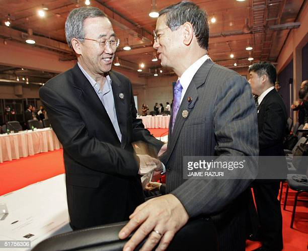 South Korea's Foreign Minister Ban Ki-Moon shake hands with his Japanese counterpart Nobutaka Machimura, before the opening of the First Meeting of...