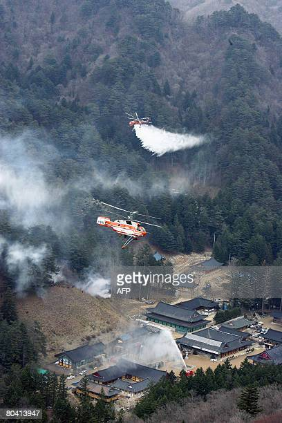 South Korea's forest Service helicopters drop water during a fire drill in Pyeongchang on on March 28 2008 South Korean forest service's firefighters...