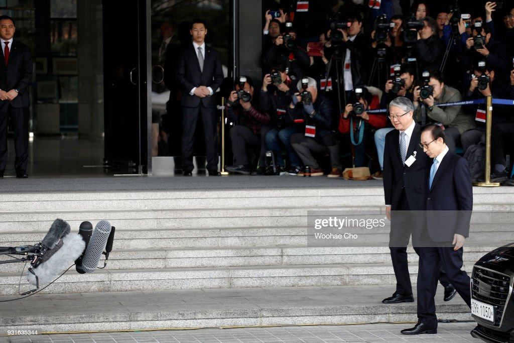 South Korea's former President Lee Myung-Bak arrives at a prosecutor's office on March 14, 2018 in Seoul, South Korea. Seoul Central District Prosecutor's Office summoned former South Korean President Lee Myung-bak for questioning on multiple cases of bribery during his 2008-2013 presidential term.
