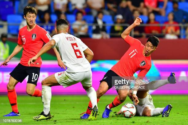 South Korea's forward HeeChan Hwang drives the ball during the 2019 AFC Asian Cup football game between Korea Republic and Philippines at the...