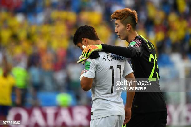 South Korea's forward Hwang Heechan and South Korea's goalkeeper Cho Hyunwoo react to the defeat following the Russia 2018 World Cup Group F football...