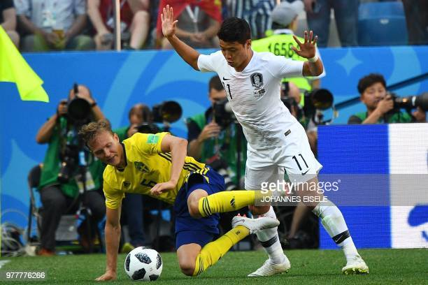 South Korea's forward Hwang Heechan fouls Sweden's defender Ludwig Augustinsson during the Russia 2018 World Cup Group F football match between...