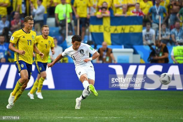 South Korea's forward Hwang Heechan passes the ball during the Russia 2018 World Cup Group F football match between Sweden and South Korea at the...