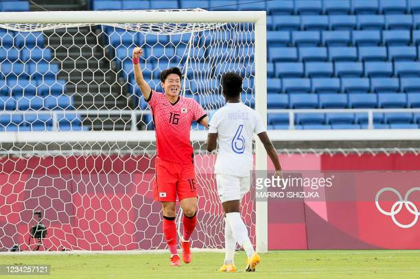 South Korea's forward Hwang Ui-jo celebrates scoring a penalty during the Tokyo 2020 Olympic Games men's group B first round football match between...