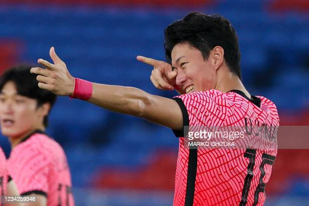 South Korea's forward Hwang Ui-jo celebrates scoring the teams's fourth goal after a penalty during the Tokyo 2020 Olympic Games men's group B first...