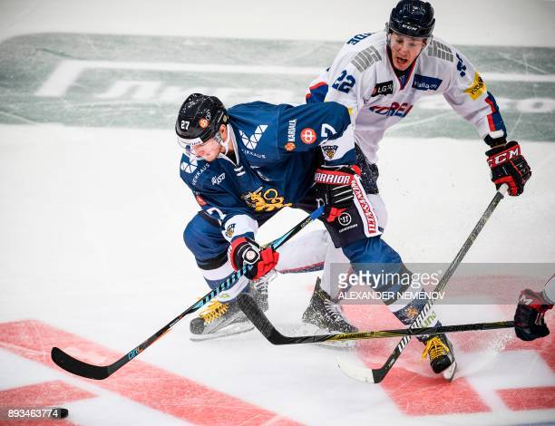 South Korea's forward Michael William Testwuide fights for the puck with Finland's forward Petri Kontiola during the Channel One Cup of the Euro...