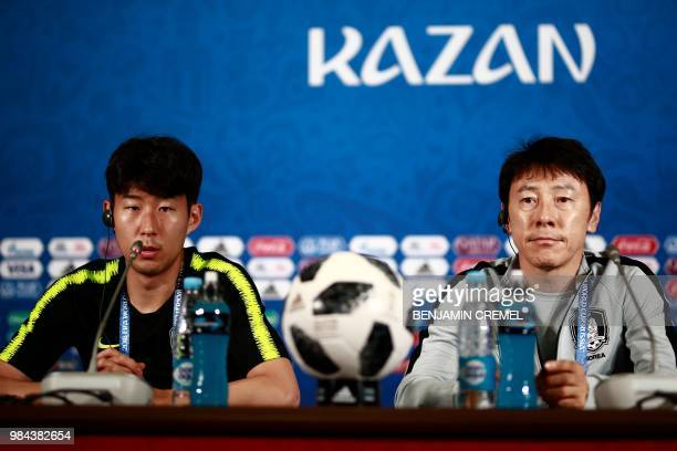 South Korea's forward Son Heungmin and South Korea's coach Shin Taeyong address a press conference in Kazan on June 26 2018 during the Russia 2018...