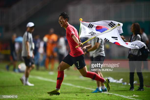 South Korea's forward Son Heungmin celebrates after defeating Japan during the men's football gold medal match at the 2018 Asian Games in Bogor on...