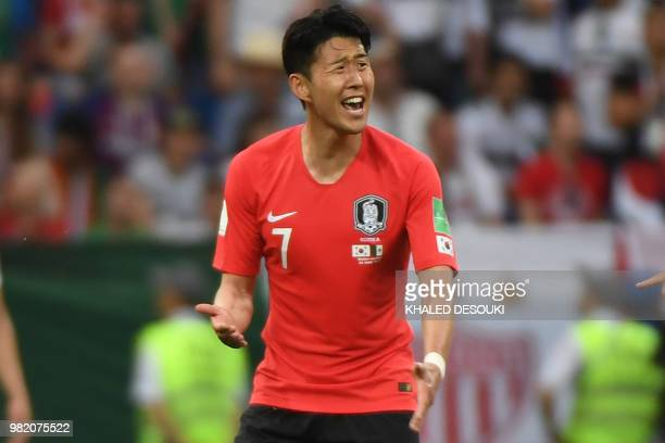 TOPSHOT South Korea's forward Son Heungmin reacts after scoring their first goal during the Russia 2018 World Cup Group F football match between...