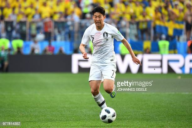 South Korea's forward Son Heungmin runs with the ball during the Russia 2018 World Cup Group F football match between Sweden and South Korea at the...