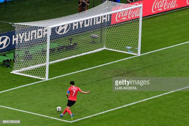 TOPSHOT South Korea's forward Son Heungmin scores his team's second goal during the Russia 2018 World Cup Group F football match between South Korea...
