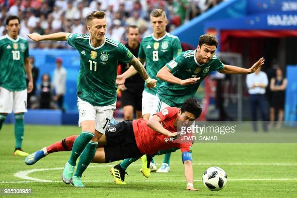 South Korea's forward Son Heungmin vies for the ball with Germany's forward Marco Reus and Germany's defender Jonas Hector during the Russia 2018...
