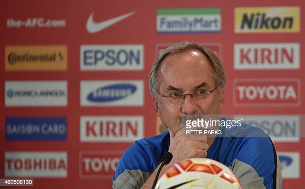 South Korea's German coach Ulrich Stielike listens to a question at a press conference before training ahead of their AFC Asian Cup final football...