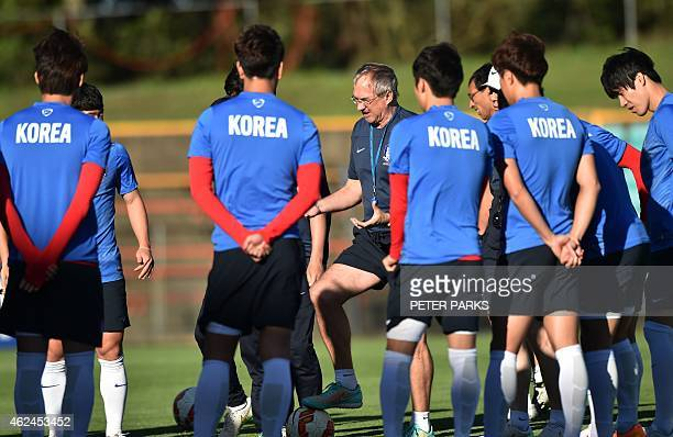 South Korea's German coach Ulrich Stielike speaks to the team before training ahead of their AFC Asian Cup final football match in Sydney on January...