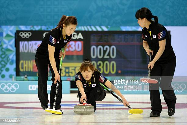 South Korea's Gim UnChi throws the stone during the Women's Curling Round Robin Session 7 against China at the Ice Cube Curling Center during the...