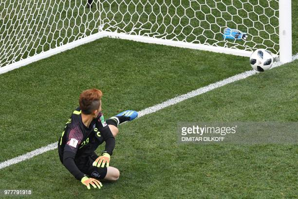 South Korea's goalkeeper Cho Hyun-woo concedes a penalty during the Russia 2018 World Cup Group F football match between Sweden and South Korea at...
