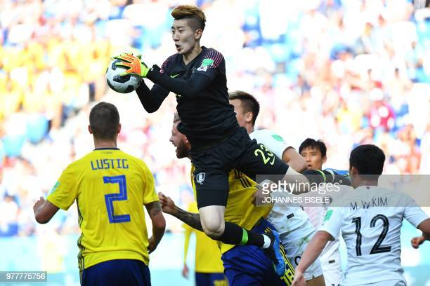 TOPSHOT South Korea's goalkeeper Cho Hyunwoo jumps to gather the corner during the Russia 2018 World Cup Group F football match between Sweden and...