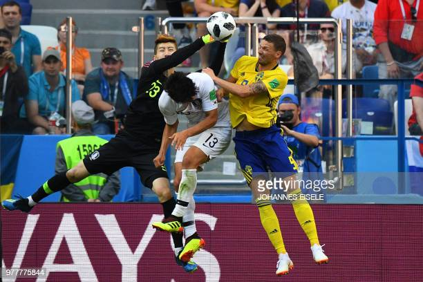 South Korea's goalkeeper Cho Hyun-woo punches the ball during the Russia 2018 World Cup Group F football match between Sweden and South Korea at the...