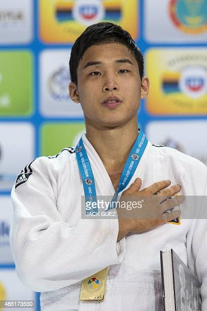 South Koreas gold medallist An Baul poses with his medal following the mens 66kg category competition at the Judo World Championships in Astana on...