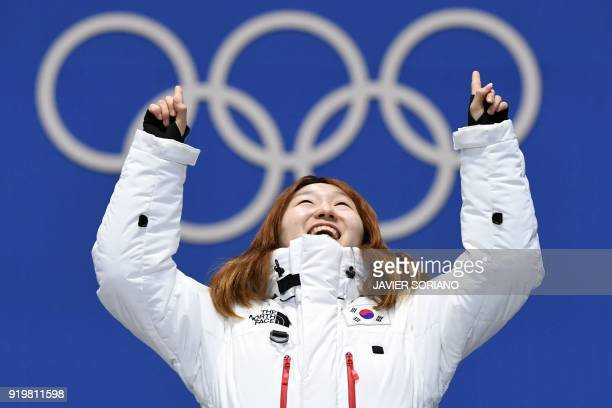 South Korea's gold medallist Choi Minjeong celebrates on the podium during the medal ceremony for the short track women's 1500m at the Pyeongchang...