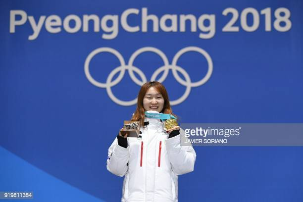 South Korea's gold medallist Choi Minjeong poses on the podium during the medal ceremony for the short track women's 1500m at the Pyeongchang Medals...