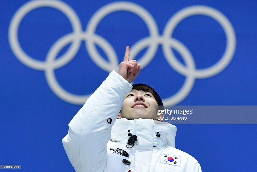TOPSHOT - South Korea's gold medallist Lim Hyo-jun celebrates on the podium during the medal ceremony for the Men's short track 1500m at the Pyeongchang Medals Plaza during the Pyeongchang 2018 Winter Olympic Games in Pyeongchang on February 11, 2018. /