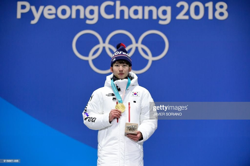 South Korea's gold medallist Lim Hyo-jun poses on the podium during the medal ceremony for the Men's short track 1500m at the Pyeongchang Medals Plaza during the Pyeongchang 2018 Winter Olympic Games in Pyeongchang on February 11, 2018. /
