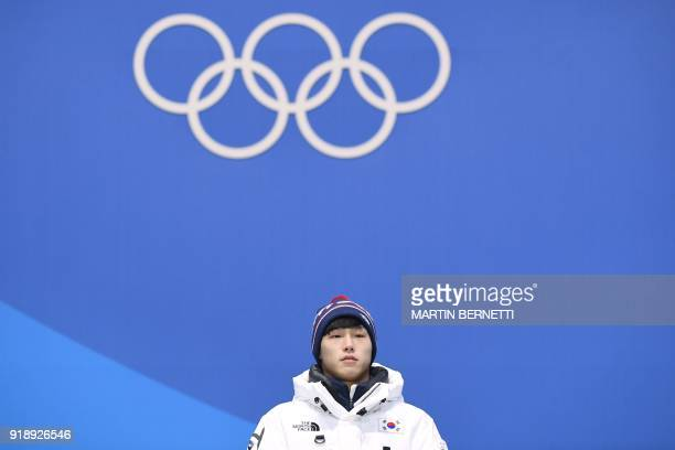 South Korea's gold medallist Yun Sungbin poses on the podium during the medal ceremony for the men's skeleton at the Pyeongchang Medals Plaza during...