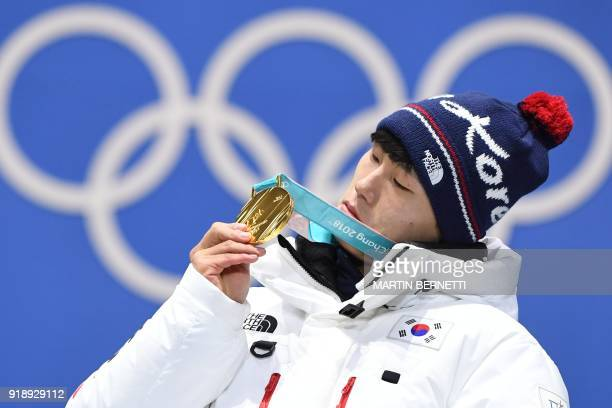 TOPSHOT South Korea's gold medallist Yun Sungbin poses on the podium during the medal ceremony for the men's skeleton at the Pyeongchang Medals Plaza...