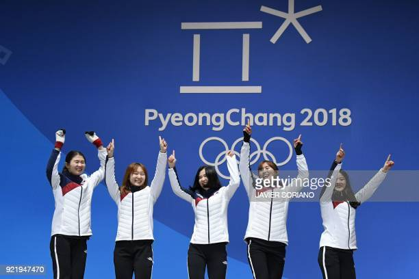 South Korea's gold medallists Shim Sukhee Choi Minjeong Kim Yejin Kim Alang and Lee Yubin pose on the podium during the medal ceremony for the short...