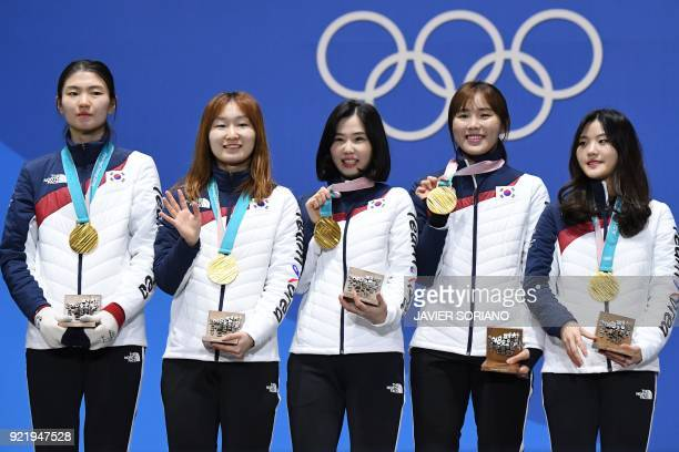 South Korea's gold medallists Shim Suk-hee, Choi Minjeong, Kim Yejin, Kim Alang and Lee Yubin pose on the podium during the medal ceremony for the...