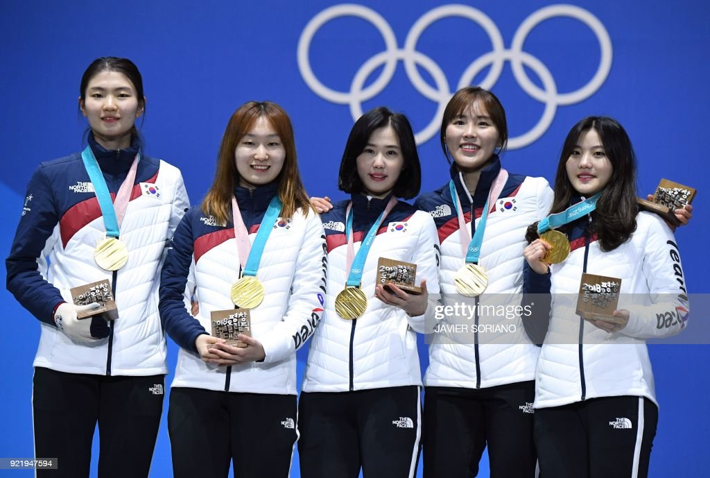 TOPSHOT - South Korea's gold medallists Shim Sukhee, Choi Minjeong, Kim Yejin, Kim Alang and Lee Yubin pose on the podium during the medal ceremony for the short track Women's 3000m relay at the Pyeongchang Medals Plaza during the Pyeongchang 2018 Winter Olympic Games in Pyeongchang on February 21, 2018. /