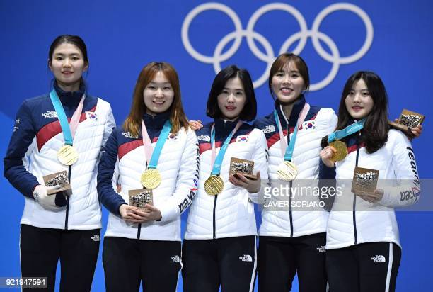 TOPSHOT South Korea's gold medallists Shim Sukhee Choi Minjeong Kim Yejin Kim Alang and Lee Yubin pose on the podium during the medal ceremony for...