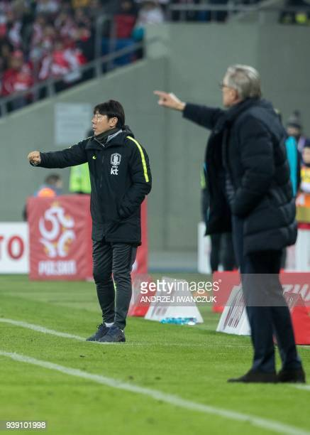 South Korea's head coach Shin Taeyong reacts next to Poland's head coach Adam Nawalka during the international friendly football match between Poland...