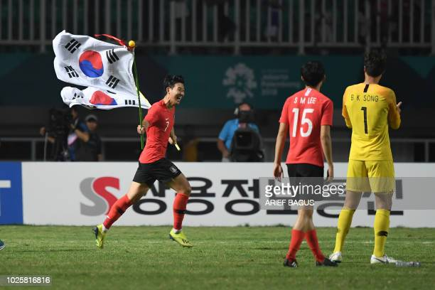 South Korea's Heung Min Son celebrates after winning against Japan in the men's gold medal football match at the 2018 Asian Games in Bogor on...