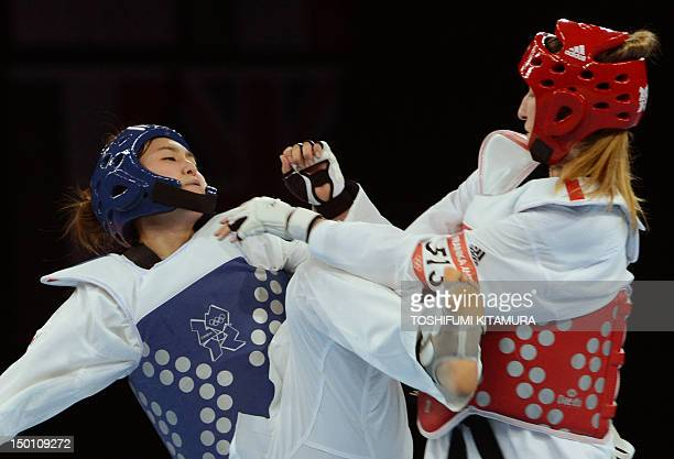South Korea's Hwang Kyung Seon fights against Slovenia's Franka Anic during their women's taekwondo semifinal bout in the category under 67 kg as...