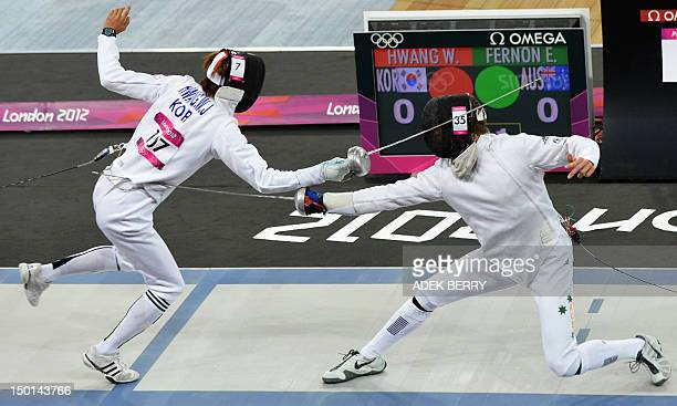 South Korea's Hwang Woojin competes against Australia's Edward Fernon during the fencing epee on touch part of the Modern Pentathlon at the London...