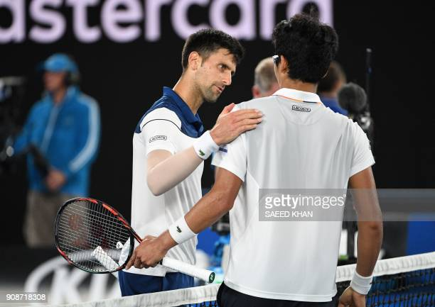 South Korea's Hyeon Chung and Serbia's Novak Djokovic talk after their men's singles fourth round match on day eight of the Australian Open tennis...