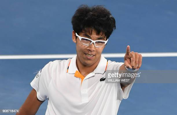 South Korea's Hyeon Chung celebrates after victory over Serbia's Novak Djokovic after their men's singles fourth round match on day eight of the...