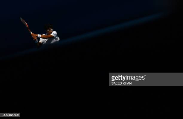 TOPSHOT South Korea's Hyeon Chung hits a return against Tennys Sandgren of the US during their men's singles quarterfinals match on day 10 of the...