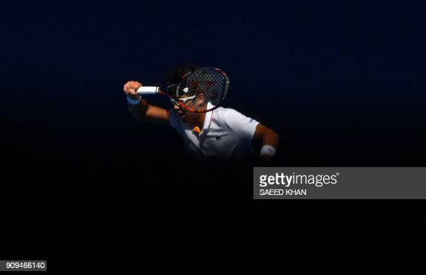 South Korea's Hyeon Chung hits a return against Tennys Sandgren of the US during their men's singles quarter-finals match on day 10 of the Australian...
