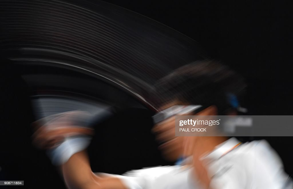 South Korea's Hyeon Chung plays a forehand return to Serbia's Novak Djokovic during their men's singles fourth round match on day eight of the Australian Open tennis tournament in Melbourne on January 22, 2018. / AFP PHOTO / Paul Crock / -- IMAGE