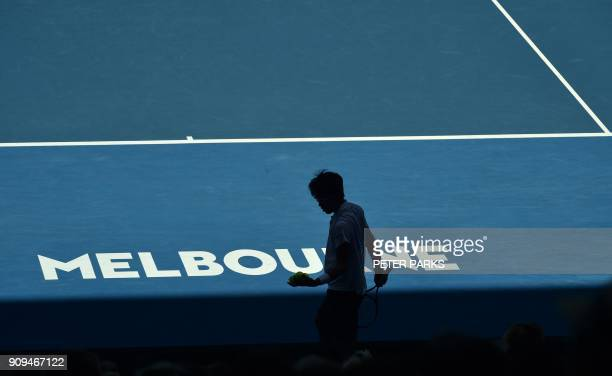 TOPSHOT South Korea's Hyeon Chung prepares to serve against Tennys Sandgren of the US during their men's singles quarterfinals match on day 10 of the...